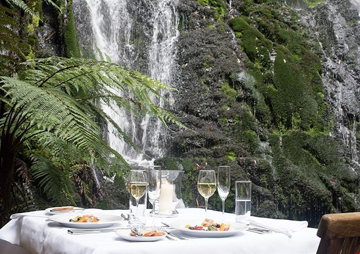 treetops-lodge-luxury-dining-waterfall